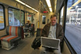 Steve Andrews (cq) does some work on a train, while heading home, Tuesday morning, November 6,...
