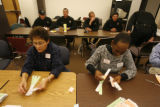 Election Commission Officials continue the count as elements of the the Police Department and SWAT...
