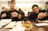 Two unidentified members of the SWAT team (foreground) stepped in to help count the ballots for...