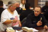 A member of the Denver Elections Comission directs members of the Denver Police Department and...