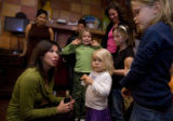 Denver Public School Board re-election candidates Theresa Peña visits with Halina Bennet, 7, back...