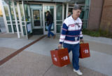 DM0774   Election official Sal Troisi removes full ballot boxes from the drop-off site at Denver...