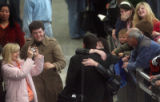 CODER101 - Jordan Jack (cq) ,back to camera, is welcomed with hugs and tears of joy  at Denver...