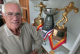 Fred Tesone, a DU Alumni, poses next to his trophies from the  CO Hall of Fame and State H.S....