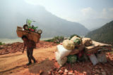 (NYT17) MIAOHE, China -- Nov. 18, 2007 -- CHINA-DAM-3 -- Liu Jun, 43, carries some of his family's...