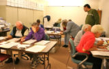 Election workers duplicate ballots which have been damaged or filled out incorrectly  inside the...