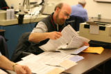 Election workers sort ballots which have been damaged or filled out incorrectly  inside the...