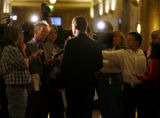Major Hickenlooper is surrounded by reporters at the City and County of Denver building after a...