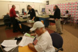 MJM754  Elections employees sort through ballots and go through the counting process at election...