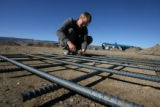 Aaron Abel (cq), works on re-bar, that will be part of the foundation of Confluence Energy's...