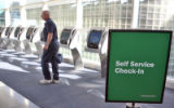 Frank Price (cq) walks away after getting his ticket at Frontier's bank of  new check-in kiosks at...