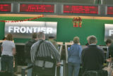 Frontier's  check-in counter at DIA on  Thursday November 8,2007.New self-serve kiosks have been...
