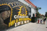 This mural, asking for peace in a crime plagued neighborhood is on the Golden Gate Grocery Store,...
