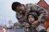 (Lakewood, Colo., October 1, 2004) Frankie Correa fixes the hood on his daughter Destiny Duncan,...