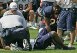 The Denver Broncos defensive tight end Alvin McKinley, right, kneels at the side of teammate,...