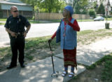 Denver Police officer Darin Lindsey (cq), left, talks to long time resident, Via Blanche Marinello...