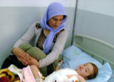 BAG102 - An injured child rests in a hospital in Dahuk, 430 kilometers (260 miles) northwest of...