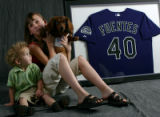 Stacie Manzanares (cq) 12, and her brother Elijah Martin, 22 months, both of Westminster, Colo.,...