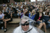 Adam Brewer, (cq) of Littleton, Colo., sports a rain poncho before The Fray took the stage at Red...