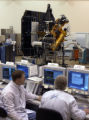 (BOULDER, Colo., October 1, 2004)   Jeremy Stober, systems engineer for the impactor, left, and...