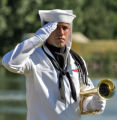 U.S. Navy Petty Officer Jarrod Greene (cq) salutes as services begin for U. S. Navy Seaman...