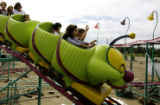 Children and parents alike prepare to roll down the steep incline during a ride at the Boulder...