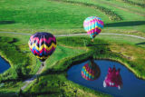 Balloons reflected in the ponds at Chatfield during inaugural flights to celebrate the 6th Annual...