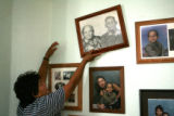 Guadalupe Castilla, cq, 52, adjusts a photo of her parents, Refugia Castorena and Julian Garcia....
