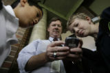 Aurora School District Superintendent John Barry(cq) shows his Blackberry phone to sixth graders...
