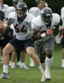 Bronco TE Daniel Graham, #89 runs a play during practice at the Denver Broncos headquarters at...