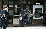 Denver Police investigate the use of an explosive device that destroyed an ATM at US Bank at 2555...