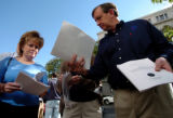 (DENVER, COLO., SEPTEMBER 16, 2004) - Randy Brown, right, shows his copy of the Columbine grand...
