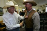 Las Animas County Rancher Tony Hass (cq) greets  Sen. Ken Salazar after Salazar met with opponents...