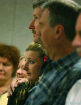 After testifying in her fiancee MItch Cozad's case Michelle Weydert(cq) 21 is hugged by her father...