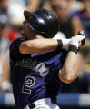 DXF108 - Colorado Rockies' Troy Tulowitzki follows the flight of his double to drive in two runs...