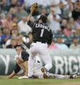 0103  Pittsburgh Pirates Adam Sanchez is caught at third by Colorado Rockies Jamey Carroll in the...