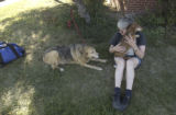 Boulder, Colo.  September 17 2004.  Belinda Levin of Eldorado Springs holds her dog Charles and...