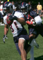 #81 Nate Jackson (front) runs after a reception while being chased by #38 Steve Cargile during...