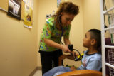 DLM0070  Medical assistant Tatiana Sandoval checks 4-year-old Bryan Villa's blood pressure before...