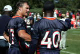 S, John Lynch, #47 helps out #40 Curome Cox with a defensive scheme  during practice at the Denver...