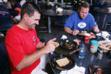 Broncos food.  Denver Broncos kicker Jason Elam (Cq), left, makes a peanut butter and jelly...