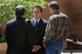 Defendent, Mitch Cozad (c) talks with his lawyer Joseph 'Andy' Gavaldon (l) and his father Richard...