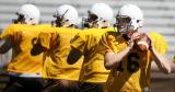 Wyoming Cowboys sophomore quarterback Karsten Sween, right, of Inyokern, Calif., throws a pass...