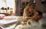 (Thornton, CO., SEPTEMBER 9, 2004) Rose Rivas caresses her daughter Shelly Rivas, 34, who is a...