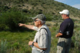 "Geologist John Trammel, of Grand Valley Anglers, shows a fenced habitat ""exclosure"" at Trapper..."