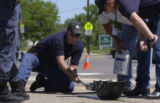 ( UNINCORPORATED  ADAMS COUNTY, CO. , May 23, 2004) Officer Rhett Newbold pulls a drag sled to...