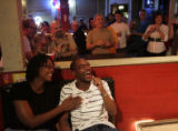 After a barrage of jokes incorporating people in the crowd, Brenda Carriger, (cq) left, and...