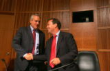 Colorado Governor Bill Ritter shakes hands with Rep. Ed Perlmutter of the Subcommittee on...
