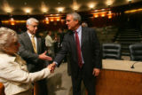Colorado Governor Bill Ritter, center, shakes hands Rep. Jane Harman, left, and Rep. David...