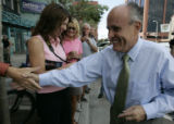 Republican presidential candidate, Rudy Giuliani is greeted by an enthusiastic crowd outside the ...